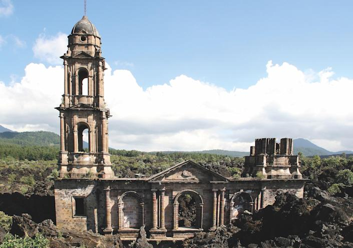 "In 1943, a volcanic eruption destroyed San Juan Parangaricutiro, but the town's church still stands. ""The power of nature is clearly demonstrated here,"" says Joffe. ""The building was not abandoned through loss of faith or any human or political factor."" The rest of the town was destroyed, which Joffe says, ""[reminds] us, again, that sacred places bizarrely and often survive where everything else disappears."""