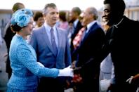 <p>The queen wore blue and white printed suiting, a matching blue hat with floral accents, and a pair of white gloves for an official visit to Jamaica.<br></p>