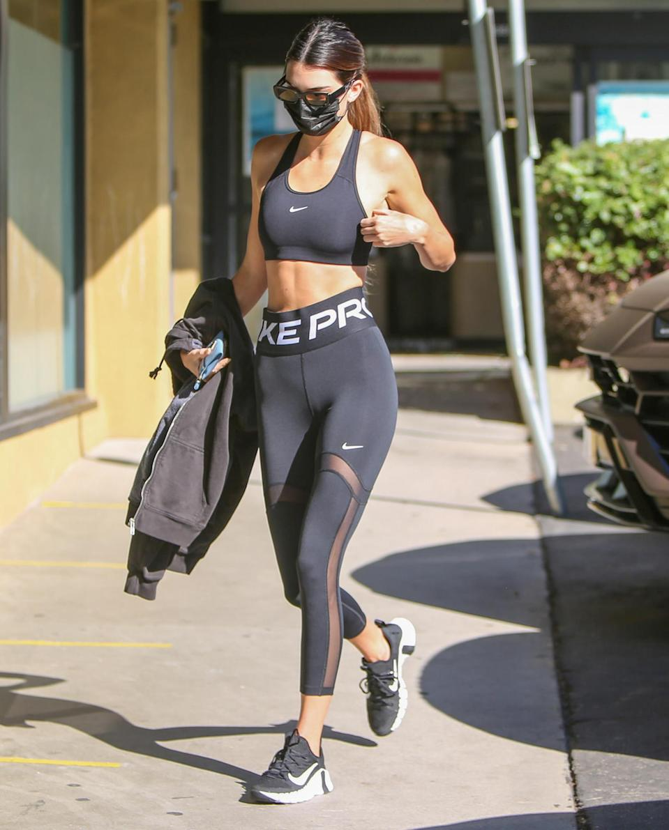 <p>Kendall Jenner steps out in a Nike two-piece workout set in L.A. on Tuesday. </p>