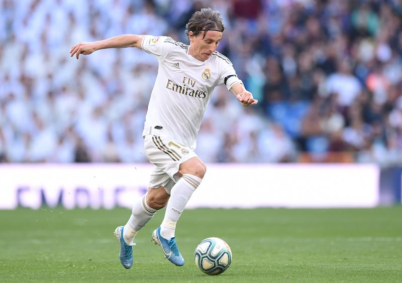 MADRID, SPAIN - FEBRUARY 01: Luka Modric of Real Madrid runs with the ball during the Liga match between Real Madrid CF and Club Atletico de Madrid at Estadio Santiago Bernabeu on February 01, 2020 in Madrid, Spain. (Photo by Denis Doyle/Getty Images)