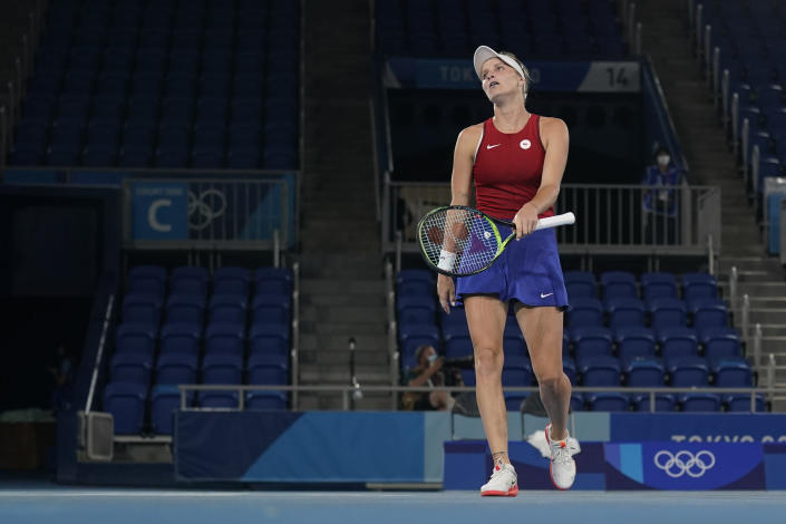 Marketa Vondrousova, of the Czech Republic, reacts during the women's gold medal match of the tennis competition against Belinda Bencic, of Switzerland, at the 2020 Summer Olympics, Saturday, July 31, 2021, in Tokyo, Japan. (AP Photo/Seth Wenig)