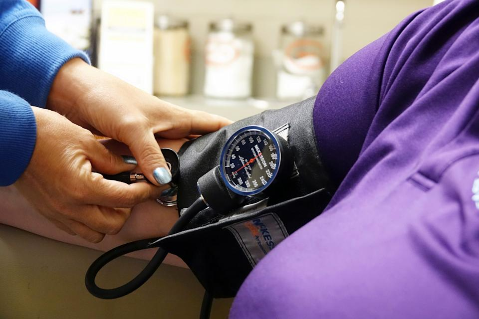 A nurse takes someones blood pressure inside the East Arkansas Family Health Center in Lepanto, Arkansas, U.S., May 2, 2018. Picture taken May 2, 2018.    To match Special Report USA-HEALTHCARE/ARKANSAS     REUTERS/Karen Pulfer Focht