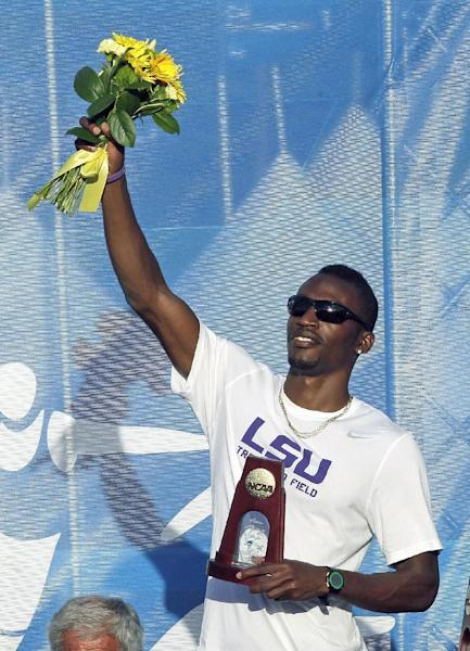 LSU's Damar Forbes holds flowers and the award after winning the men's long jump during the NCAA outdoor track and field championships in Eugene, Ore., Thursday, June 6, 2013. Forbes won with a leap of 27 feet, 4 3/4 inches. (AP Photo/Don Ryan)