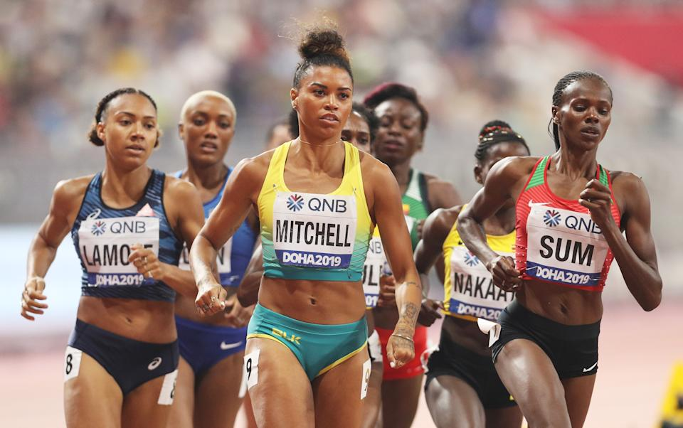 Morgan Mitchell of Australia and Eunice Jepkoech Sum of Kenya compete in the Women's 800 metres Heat 3 semi finals during day two of 17th IAAF World Athletics Championships Doha 2019
