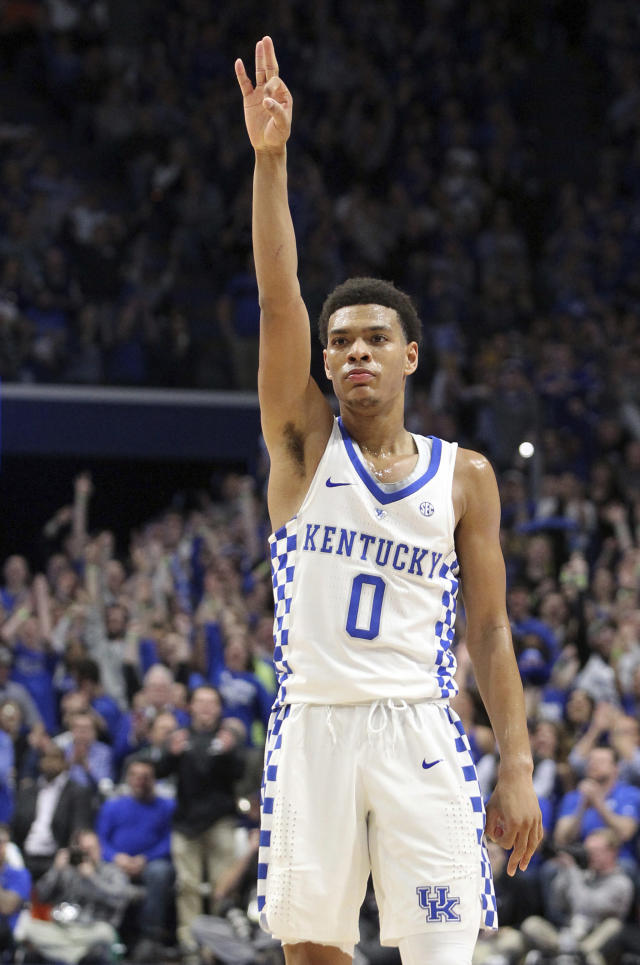 Kentucky's Quade Green celebrates his 3-point basket during the first half of an NCAA college basketball game against Missouri, Saturday, Feb. 24, 2018, in Lexington, Ky. (AP Photo/James Crisp)