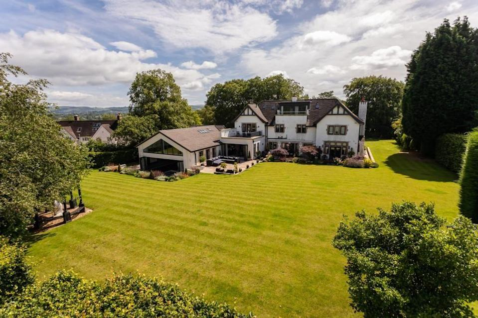 """<p>Situated in the heart of the Cheshire countryside, this remarkable home has a stunning pool and leisure facilities, plus a games room, impressive garden and stunning kitchen. Just look at the garden! </p><p><a href=""""https://www.rightmove.co.uk/property-for-sale/property-58148001.html"""" rel=""""nofollow noopener"""" target=""""_blank"""" data-ylk=""""slk:This property is on the market for £3,950,000 via Gascoigne Halman at Rightmove"""" class=""""link rapid-noclick-resp"""">This property is on the market for £3,950,000 via Gascoigne Halman at Rightmove</a>. </p>"""