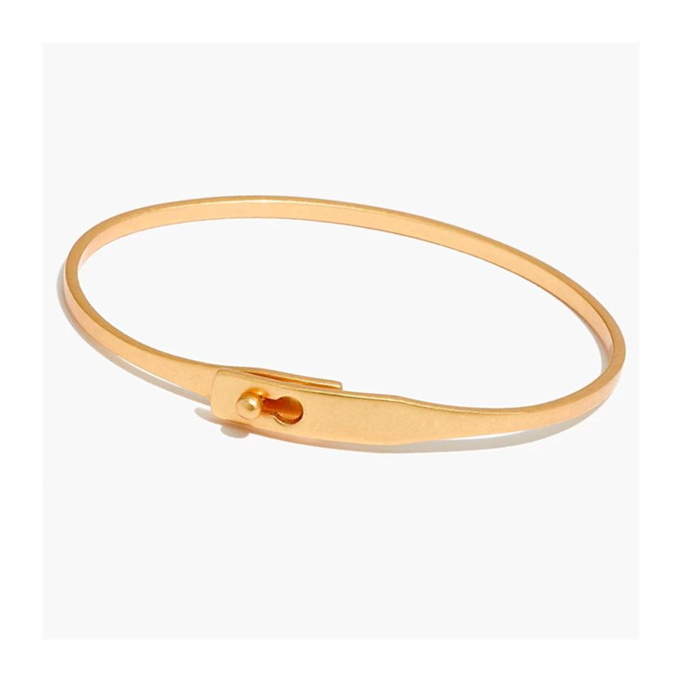 <p>A simple and stackable gold bangle is an everyday jewelry piece that will become their favorite accessory in no time. No one would believe this pretty bracelet is only $20. </p>