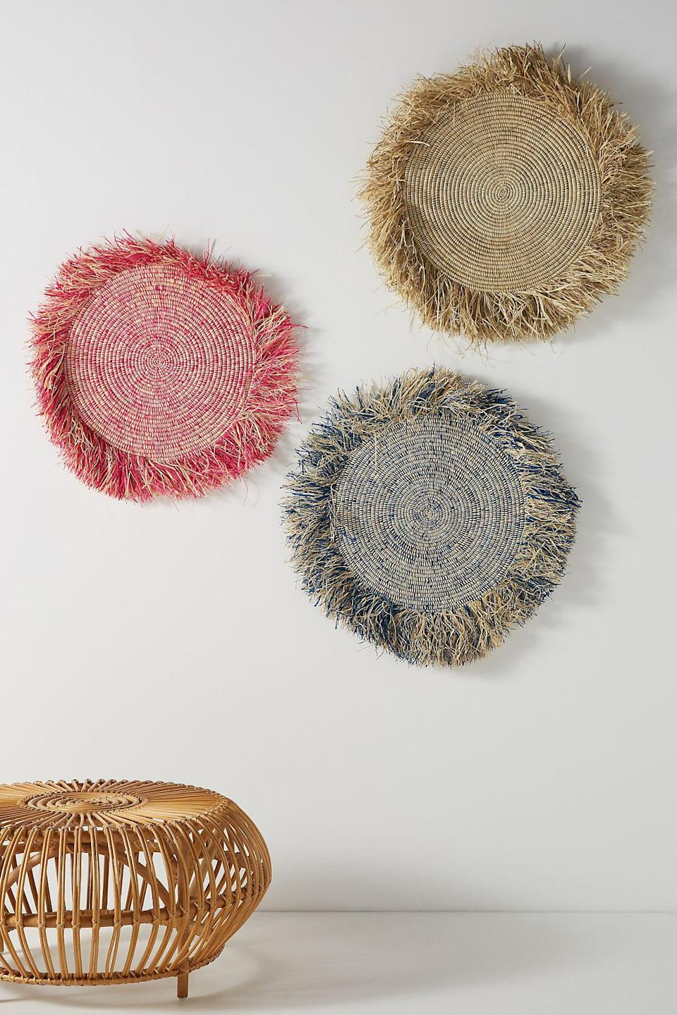 """<h3><a href=""""https://www.anthropologie.com/decor-art"""" rel=""""nofollow noopener"""" target=""""_blank"""" data-ylk=""""slk:Anthropologie"""" class=""""link rapid-noclick-resp"""">Anthropologie</a></h3><br>We love anything and everything from Anthropologie's home & furniture section, and its collection of wall art is no exception. They've got plenty of bohemian-cool, handcrafted decor items including a great selection of woven basket situations that are made to be mounted on the wall.<br><br><strong>All Across Africa</strong> Fringed Hanging Basket, $, available at <a href=""""https://go.skimresources.com/?id=30283X879131&url=https%3A%2F%2Fwww.anthropologie.com%2Fshop%2Ffringed-hanging-basket"""" rel=""""nofollow noopener"""" target=""""_blank"""" data-ylk=""""slk:Anthropologie"""" class=""""link rapid-noclick-resp"""">Anthropologie</a>"""