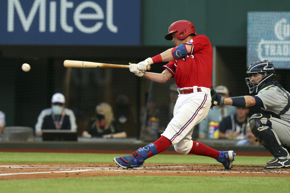 Texas Rangers Nick Solak connects for an RBI single during the first inning against the Seattle Mariners in a baseball game Friday, May 7, 2021, in Arlington, Texas. (AP Photo/Richard W. Rodriguez)