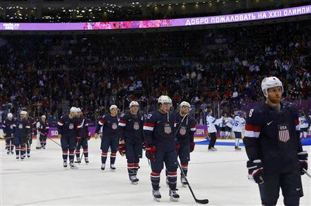Team USA players leave the ice after being defeated by Finland in their men's ice hockey bronze medal game at the Sochi 2014 Winter Olympic Games February 22, 2014. REUTERS/Laszlo Balogh
