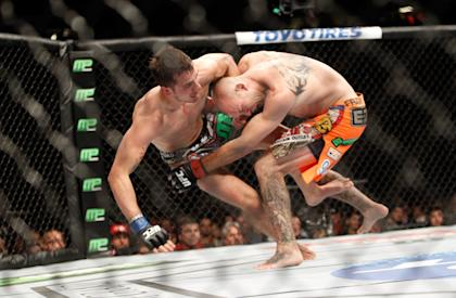 Donald Cerrone takes down Myles Jury during their UFC 182 fight. (Getty)