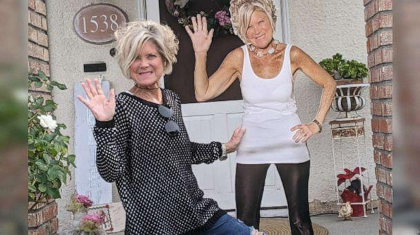 PHOTO: Debbie Hays (left) pictured with a cutout image of herself to display in her mom's room, who is battling COVID-19.  (Debbie Hays)
