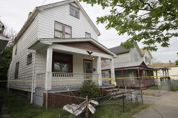 """FILE - This May 7, 2013, file photo, shows a house where three women, Amanda Berry, Gina DeJesus and Michelle Knight, who went missing separately about a decade ago, escaped from captivity in Cleveland. Attorneys for two women held in the Cleveland home and abused for a decade say comedian Joan Rivers should apologize for comparing living in her daughter's guest room with the captivity they experienced. Rivers and her daughter were discussing their reality show Tuesday, April 22, 2014, on NBC's """"Today"""" show when she complained about her living arrangements, saying, """"Those women in the basement in Cleveland had more space."""" (AP Photo/Tony Dejak, File)"""
