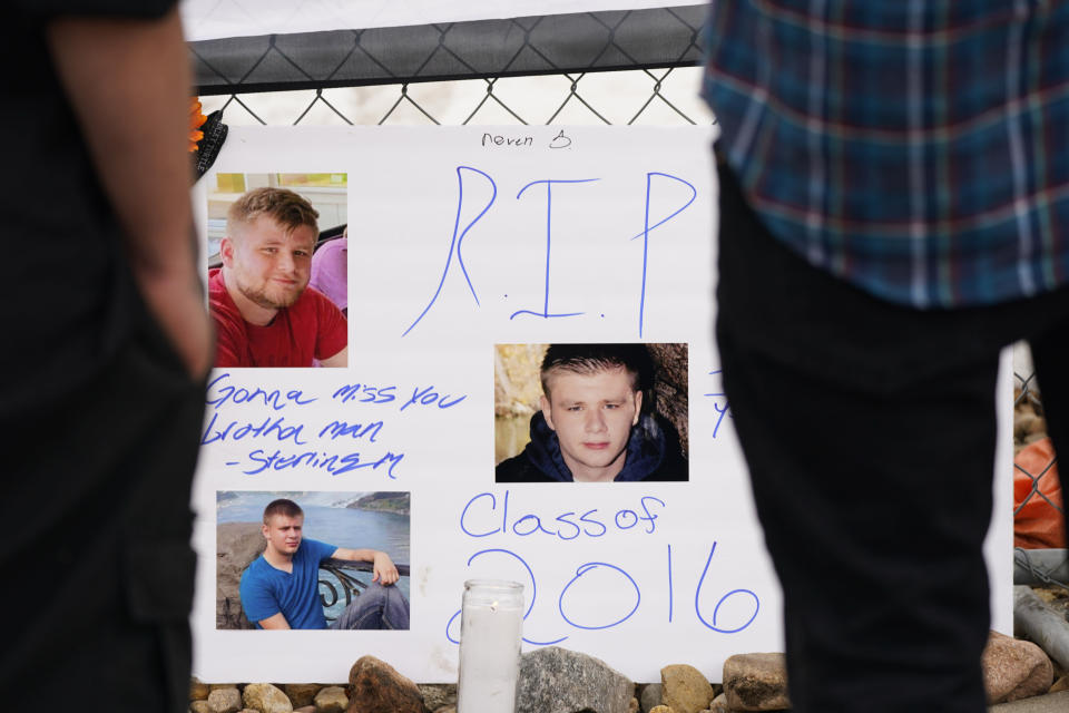 A sign stands in tribute to Neven Stanisic, one of the victims of a mass shooting, on the temporary fence around a King Soopers grocery store, where 10 people died Monday in an attack, Wednesday, March 24, 2021, in Boulder, Colo. (AP Photo/David Zalubowski)