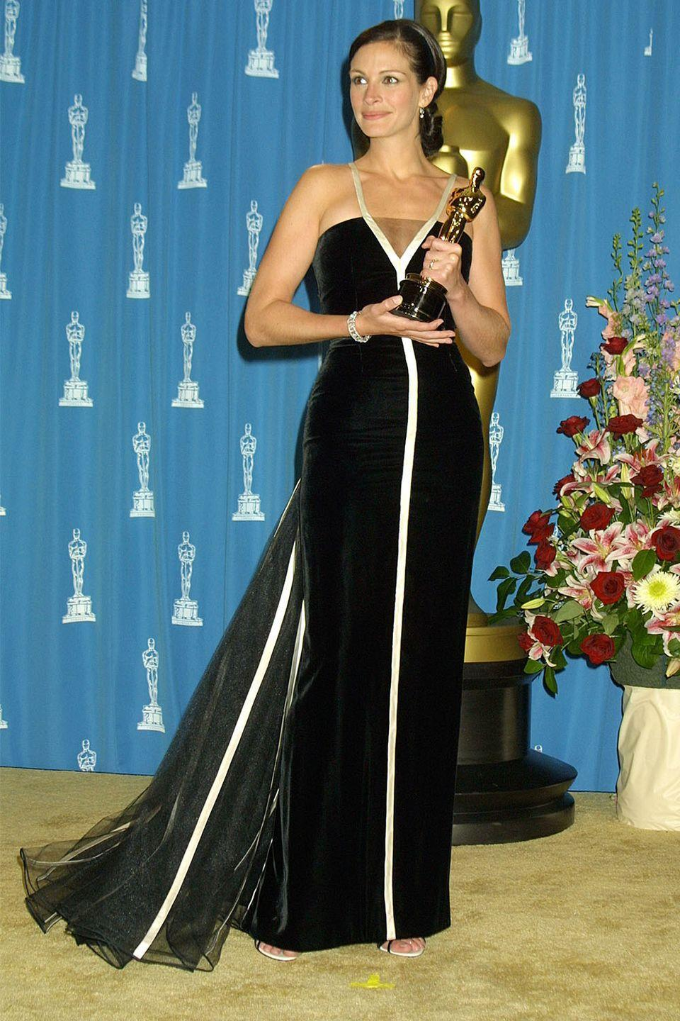 <p>Julia Roberts took home the big award for her role in <em>Erin Brockovich </em>in this timeless Valentino gown. </p>