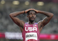 Trayvon Bromell, of United States, looks up after finishing a semifinal of the men's 100-meters at the 2020 Summer Olympics, Sunday, Aug. 1, 2021, in Tokyo, Japan. (AP Photo/Martin Meissner)