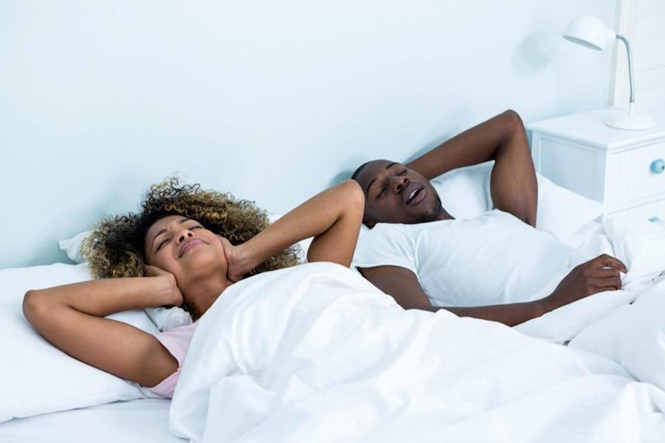 """Though snoring may seem harmless (or simply annoying), the <a href=""""https://urldefense.proofpoint.com/v2/url?u=https-3A__aasm.org_&d=DwMF-g&c=aqMfXOEvEJQh2iQMCb7Wy8l0sPnURkcqADc2guUW8IM&r=qeW5mNKohu8xmIlEmLA3CjUmi2zeb4xByN7GQn0JW5E&m=Acq04MLB1wP5u5EVrdNZWikqEeerAe7eFrhf_QxfANQ&s=MV3QflFwp6fna3nYMMnrtp4lr0SiVrzEXqbVDq_e4CY&e="""" rel=""""nofollow noopener"""" target=""""_blank"""" data-ylk=""""slk:American Academy of Sleep Medicine"""" class=""""link rapid-noclick-resp"""">American Academy of Sleep Medicine</a> (AASM) says it could be a sign of something more serious. According to the AASM, heavy snoring may be associated with <a href=""""https://bestlifeonline.com/sleeping-positions/?utm_source=yahoo-news&utm_medium=feed&utm_campaign=yahoo-feed"""" rel=""""nofollow noopener"""" target=""""_blank"""" data-ylk=""""slk:obstructive sleep apnea"""" class=""""link rapid-noclick-resp"""">obstructive sleep apnea</a>—a severe sleep disorder—and a risk factor for heart disease, stroke, diabetes, and many other health problems that become even more prevalent after your 40th birthday. Sleep apnea involves the repeated collapse of the upper airway during sleep. It puts an enormous strain on the heart by repeatedly causing oxygen levels to drop and blood pressure to surge as one sleeps. So it's definitely something you want to address."""