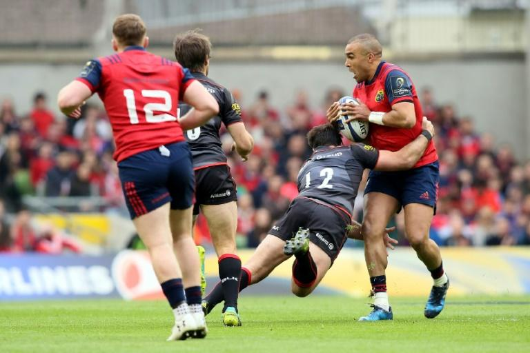 Munster's full-back Simon Zebo (R) is tackled by Saracens' Brad Barritt (2R) during their rugby union Champions Cup semi-final match in Dublin on April 22, 2017