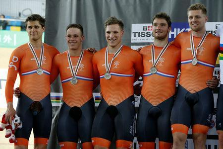 Cycling - UCI Track World Championships - Men's Team Sprint, Final - Hong Kong, China - 12/4/17 - Team members of the Netherlands celebrate with silver medals. REUTERS/Bobby Yip