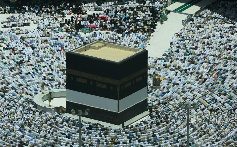 Muslim worshippers pray around the Kaaba, Islam's holiest shrine, at the Grand Mosque in Saudi Arabia's holy city of Mecca on August 16, 2018