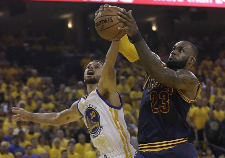 LeBron James battles for the ball during Game 1 of the 2017 NBA Finals. (AP)