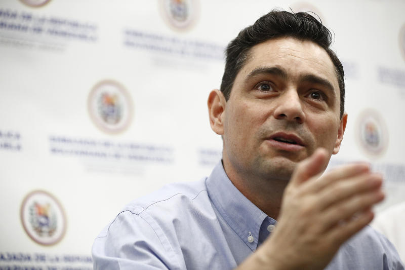 Carlos Vecchio, a government opponent who the U.S. recognizes as Venezuela's ambassador, speaks during a news conference on Tuesday, June 11, 2019, in Miami. President Donald Trump says his administration is considering granting Temporary Protected Status to thousands of Venezuelans including Vecchio who have fled to the United States amid ongoing unrest. (AP Photo/Brynn Anderson)