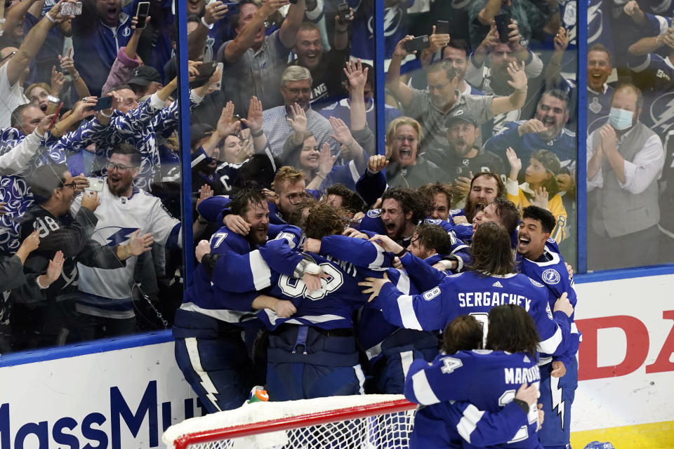 FILE - In this July 7, 2021, file photo, the Tampa Bay Lightning celebrate their series win over the Montreal Canadiens to clinch the Stanley Cup in Game 5 of the NHL hockey finals in Tampa, Fla. (AP Photo/Gerry Broome, File)