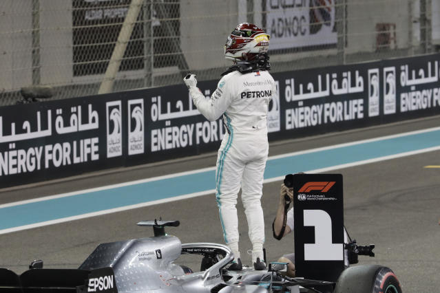 Mercedes driver Lewis Hamilton of Britain celebrates pole position during the qualifying session at the Yas Marina racetrack in Abu Dhabi, United Arab Emirates, Saturday, Nov. 30, 2019. The Emirates Formula One Grand Prix will take place on Sunday. (AP Photo/Luca Bruno)