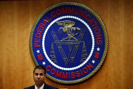 FILE PHOTO - Chairman Ajit Pai speaks ahead of the vote on the repeal of so called net neutrality rules at the Federal Communications Commission in Washington, U.S., December 14, 2017. REUTERS/Aaron P. Bernstein