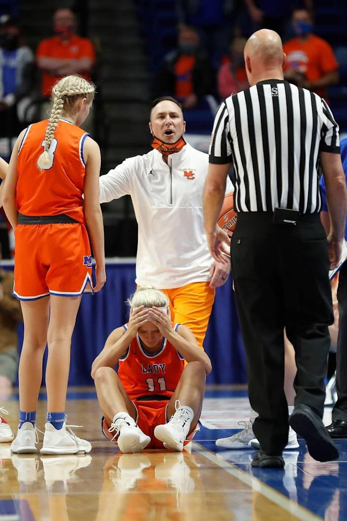 Marshall County's Cayson Conner (11) and Coach Aaron Beth react to a call late in the fourth quarter of Sacred Heart's state championship win in Rupp Arena on Saturday night. Conner fell to the floor trying to collect an inbounds pass with 1.3 seconds remaining but no foul was whistled.