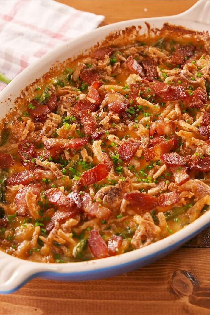 """<p>Has bacon, chives, and SO much cheese. </p><p>Get the recipe from <a href=""""https://www.delish.com/holiday-recipes/thanksgiving/a24399597/loaded-green-bean-casserole-recipe/"""" rel=""""nofollow noopener"""" target=""""_blank"""" data-ylk=""""slk:Delish"""" class=""""link rapid-noclick-resp"""">Delish</a>. </p>"""