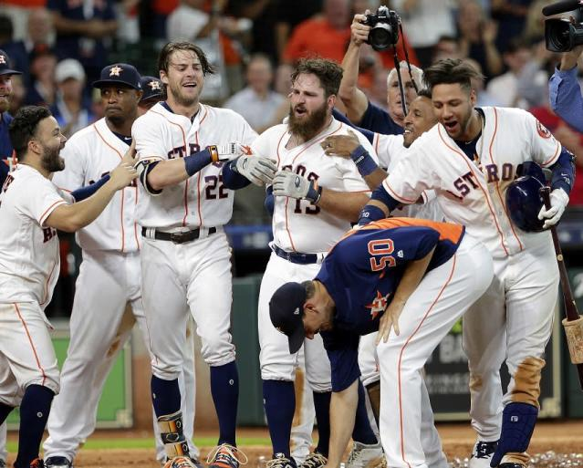 Astros DH Tyler White (middle) launched MLB's record-setting 81st walk-off home run of the season. (AP)