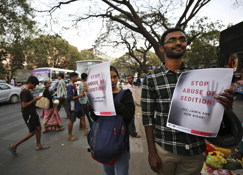 In this Tuesday, Feb. 4, 2020 photo, Indians hold placards during a protest against the sedition case filed by police against a school after a play preformed by students denouncing a new citizenship law, in Bangalore, India. Critics, intellectuals, human rights activists, filmmakers, students and journalists in seen as opposed to Indian Prime Minister Narendra Modi'sgovernment are being increasingly silenced under a colonial-era sedition law. Official data reveal as many as 332 people were arrested under the law between 2016 and 2018, though only seven were convicted, suggesting that the policehave struggled to gather evidence against the accused. (AP Photo/Aijaz Rahi)