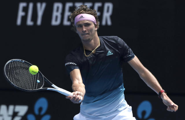 Germany's Alexander Zverev makes a forehand return to Slovenia's Aljaz Bedene during their first round match at the Australian Open tennis championships in Melbourne, Australia, Tuesday, Jan. 15, 2019. (AP Photo/Kin Cheung)