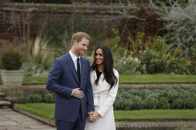Prince Harry and his fiancee Meghan Markle posed for photographers during a photocall on the grounds of Kensington Palace. (AP Photo/Matt Dunham)