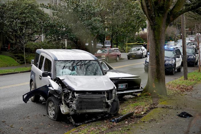 A wrecked vehicle is seen after a driver struck and injured at least six people over a 20-block stretch before crashing on Monday in Portland, Ore.