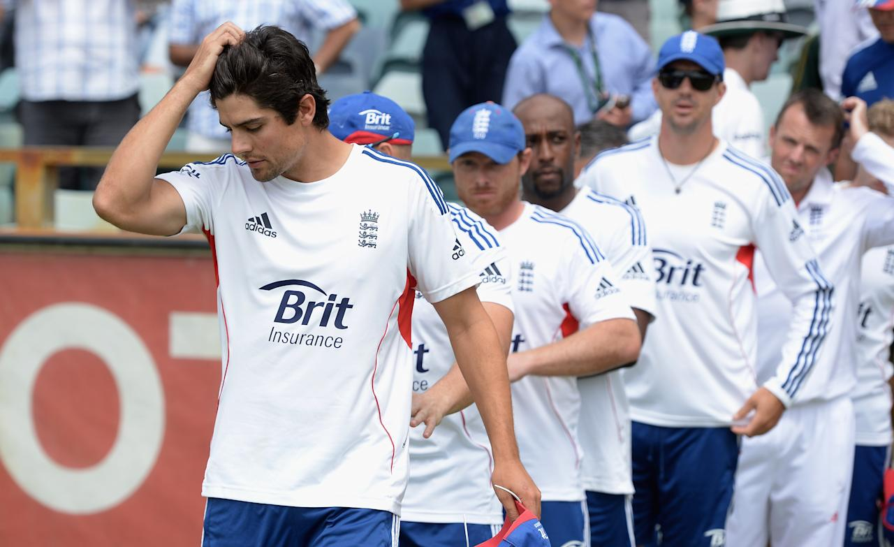 PERTH, AUSTRALIA - DECEMBER 17:  England captain Alastair Cook leads his team on to the field after losing the Third Ashes Test Match between Australia and England at WACA on December 17, 2013 in Perth, Australia.  (Photo by Gareth Copley/Getty Images)