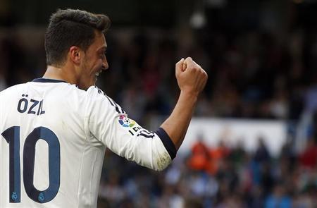 Real Madrid's Mesut Ozil celebrates his goal during their Spanish First Division soccer match against Real Betis at Santiago Bernabeu stadium in Madrid April 20, 2013. REUTERS/Juan Medina/Files