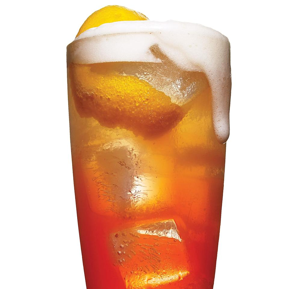 """This take on the Aperol Spritz gets a creamy texture from Hefeweizen and brightness from a touch of lemon. <a href=""""https://www.epicurious.com/recipes/food/views/aperol-mist-51238330?mbid=synd_yahoo_rss"""" rel=""""nofollow noopener"""" target=""""_blank"""" data-ylk=""""slk:See recipe."""" class=""""link rapid-noclick-resp"""">See recipe.</a>"""