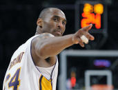 FILE - In this June 7, 2009, file photo, Los Angeles Lakers guard Kobe Bryant (24) points to a player behind him after making a basket in the closing seconds against the Orlando Magic in Game 2 of the NBA basketball finals in Los Angeles. Federal safety officials are expected to vote Tuesday, Feb. 9, 2021, on what likely caused the helicopter carrying Kobe Bryant, his 13-year-old daughter and seven others to crash into a Southern California hillside last year, killing all aboard. (AP Photo/Mark J. Terrill, file)