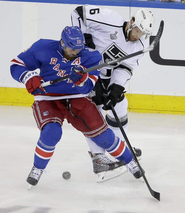New York Rangers center Brad Richards (19) vies for the puck against Los Angeles Kings defenseman Jake Muzzin (6) in the first period during Game 4 of the NHL hockey Stanley Cup Final, Wednesday, June 11, 2014, in New York. (AP Photo/Frank Franklin II)