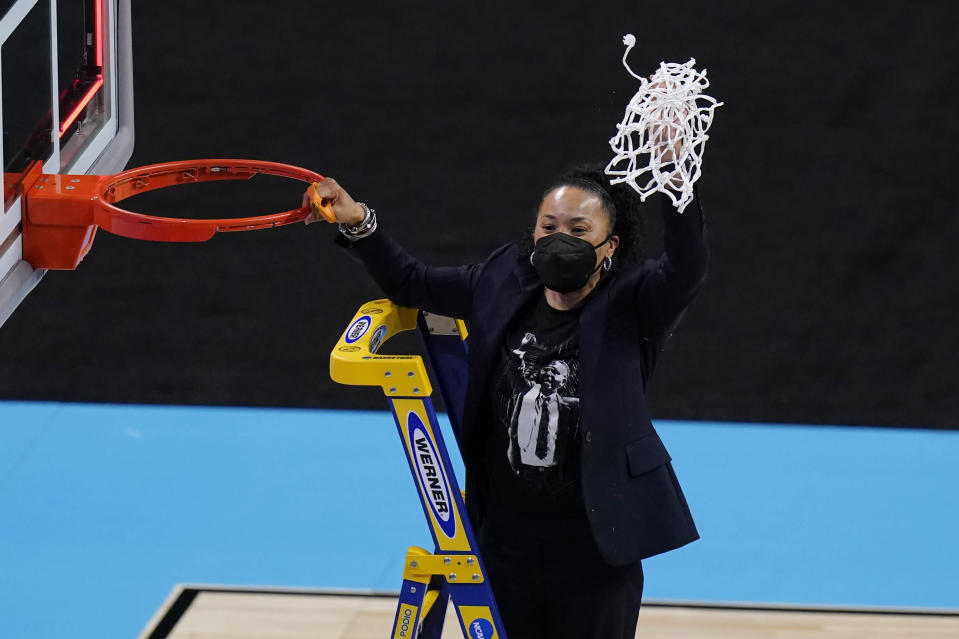 South Carolina head coach Dawn Stanley cuts down the net after the team's win over Texas in a college basketball game in the Elite Eight round of the women's NCAA tournament at the Alamodome in San Antonio, Tuesday, March 30, 2021. (AP Photo/Eric Gay)