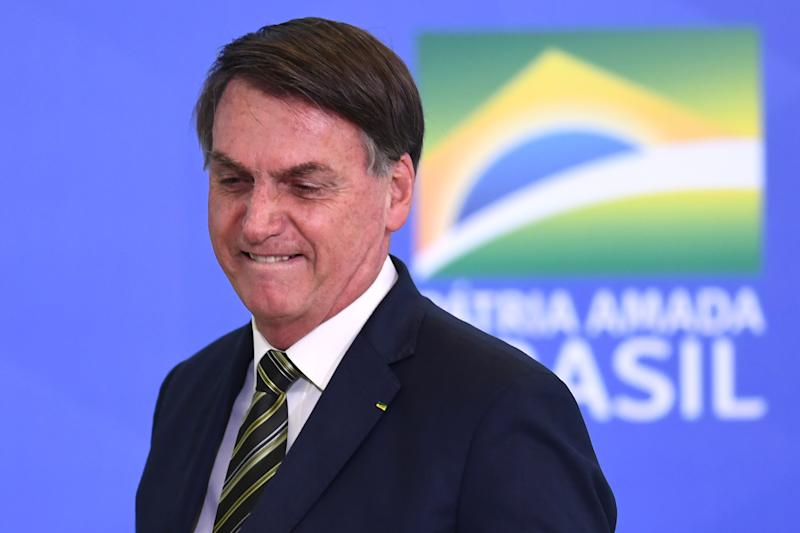 Brazilian President Jair Bolsonaro gestures during the inauguration ceremony of Andre Mendonca as new Justice Minister at Planalto Palace in Brasilia, on April 29, 2020. - Mendonca replaces Sergio Moro, who resigned after disagreements with President Bolsonaro. (Photo by EVARISTO SA / AFP) (Photo by EVARISTO SA/AFP via Getty Images)