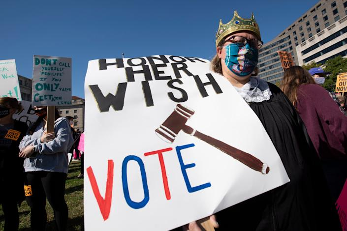 People rally during the Women's March at Freedom Plaza, Saturday, Oct. 17, 2020, in Washington. (AP Photo/Jose Luis Magana)
