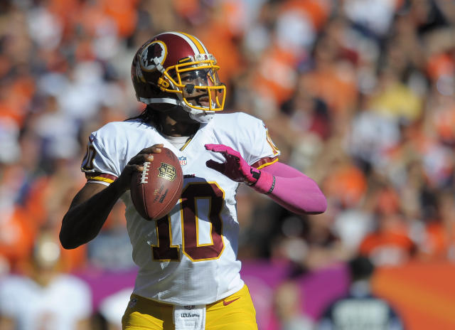 Washington Redskins quarterback Robert Griffin III (10) looks to pass against the Denver Broncos in the first quarter of an NFL football game, Sunday, Oct. 27, 2013, in Denver. (AP Photo/Jack Dempsey)