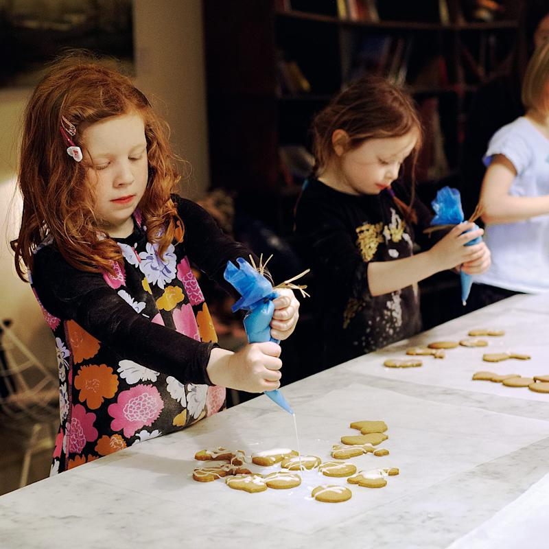 Five-year-olds Coco (left) and Bea get to grips with icing - Credit: Haarala Hamilton