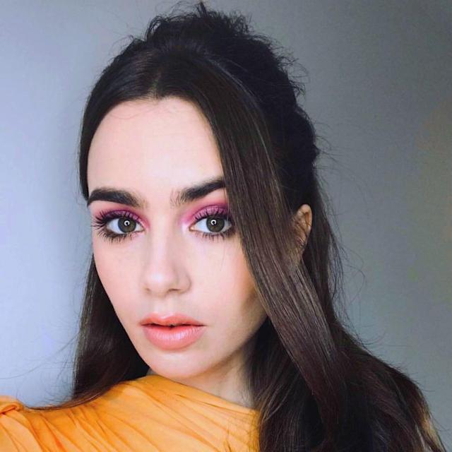 "<a href=""https://www.allure.com/topic/lily-collins?mbid=synd_yahoo_rss"" rel=""nofollow noopener"" target=""_blank"" data-ylk=""slk:Lily Collins"" class=""link rapid-noclick-resp"">Lily Collins</a> could smear grape jelly on her eyelids and make it look stunning, but in this case makeup artist <a href=""https://www.instagram.com/p/BtZawfKnYqc/"" rel=""nofollow noopener"" target=""_blank"" data-ylk=""slk:Vincent Oquendo"" class=""link rapid-noclick-resp"">Vincent Oquendo</a> opted for actual eye shadow in a jam-like shade of vivid purple. The color is blended past Collins's crease and brightened even more with a shimmering highlight at the inner corners of her eyes. Oquendo emboldened the already striking look with lots of mascara, but he kept her cheeks and lips low-key and fresh with pale peach blush and gloss."
