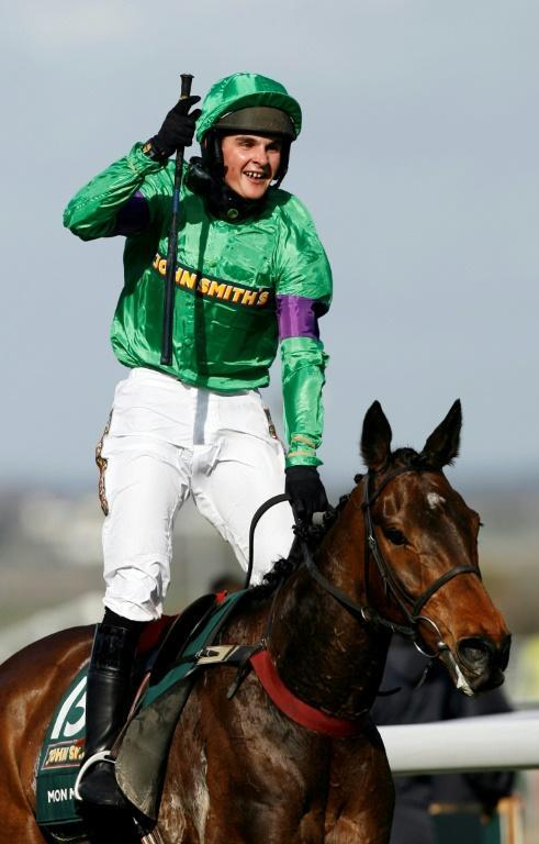 Liam Treadwell, pictured after riding 100/1 shot Mon Mome to victory in the 2009 Grand National, has died aged 34 (AFP Photo/GLYN KIRK)