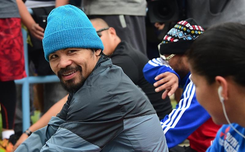 Boxer Manny Pacquiao is seen during a workout at a park following his morning jog in Los Angeles, California on April 21, 2015