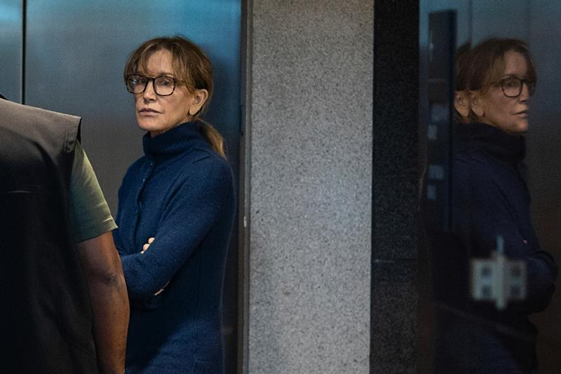 Actress Felicity Huffman is seen inside the Edward R. Roybal Federal Building and US Courthouse in Los Angeles, on March 12, 2019 (AFP Photo/DAVID MCNEW)